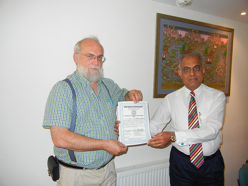 Subrata awarding the Certificate to Dr. Philippe from Belgium, who attended all the Summer Conferenc