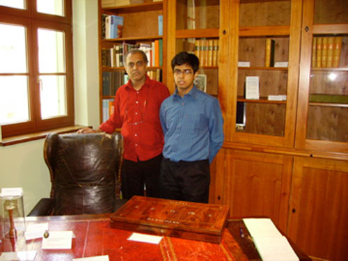 Subrata and Saptarshi at Hahnemann's Consulting Room in Koethen behind Hahnemann's original chair an