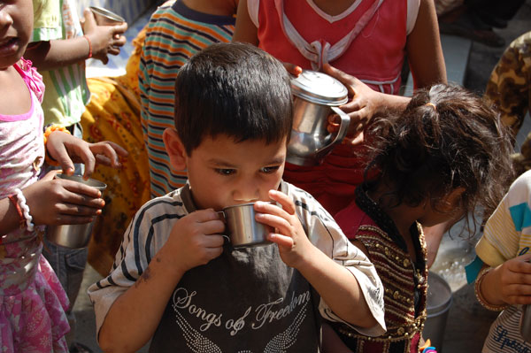 Milk provided for the Slum children.