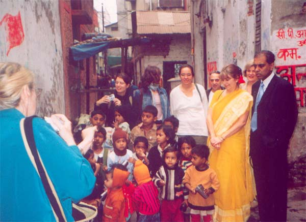 Subrata & Janet with the overseas homoeopaths at Calcutta Slum Clinic  ( February 2004 )